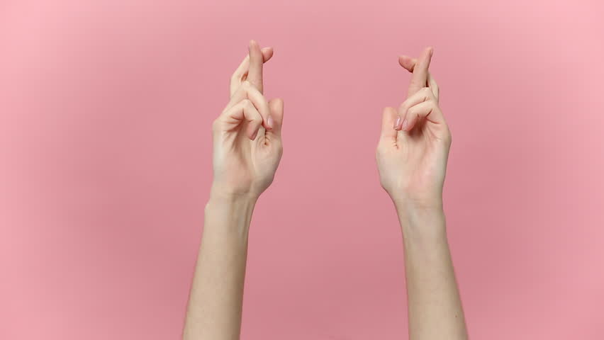 Woman hands keeping fingers crossed, waiting for special moment, making wish isolated over pastel pink background in studio. Copy space for advertisement. With place text or image promotional content. | Shutterstock HD Video #1027177958