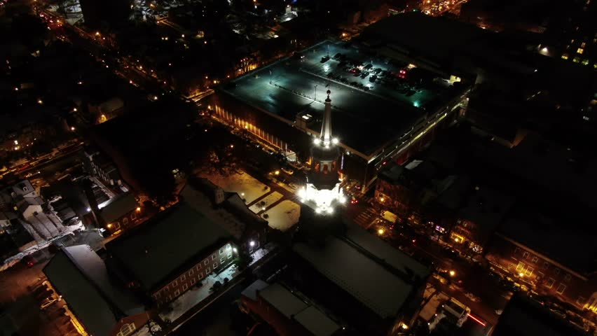 Aerial high angle past the steeple of Holy Trinity Lutheran Church to downtown traffic Lancaster Pennsylvania Concept: traffic, urban, downtown, cars, trucks, lights, rat race, church,steeple | Shutterstock HD Video #1027223768