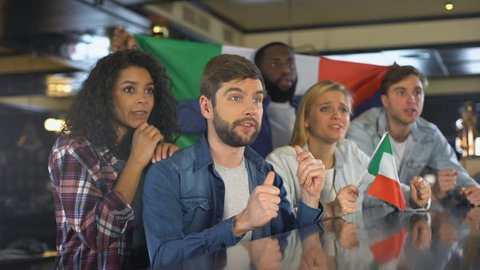 Sport fans with Italian flag enjoying tournament, celebrating winning game