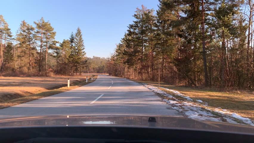 POV. Driving car in the sun | Shutterstock HD Video #1027386848