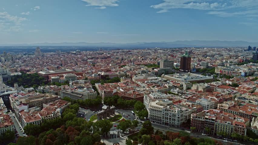 Aerial Drone, Tilt Down, Puerta de Alcalá, Over Town Madrid, Calle de Alcalá, Torres de Colón, Flag of Spain, Spain 4k | Shutterstock HD Video #1027456298
