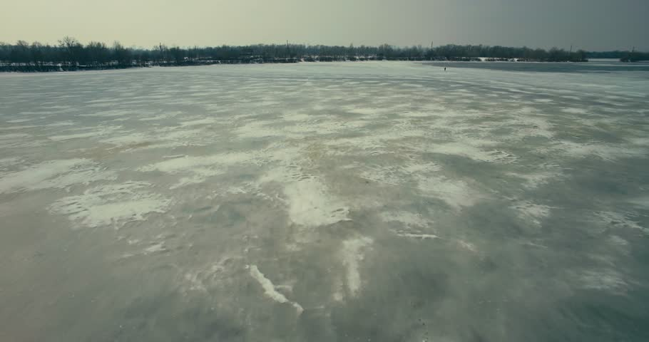 Aerial Frozen River And Lake.Drone Frozen River.Aerial Ice Covered Water. Aerial Frozen Pond Cloudy Gray Sky.Drone Ice And Snow. Drone Frozen Pond.Winter Ice. Gray Winter Day.Snow On Ice.Frost Winter.