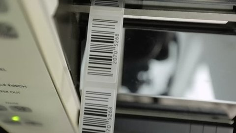 Closeup on barcode enterprise printer when printing barcode labels