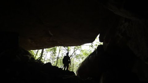 Chapada dos Guimarães, Mato Grosso / Brazil - 03/30/2019: silhouette of man in the entrance of Kiogo Brado Cave