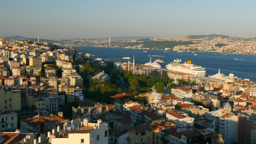 Istanbul at sunset lights, Turkey. Bosphorus divides the city into the Asian  and European parts. View from the European side