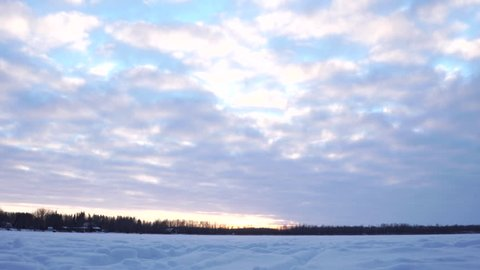 Evening timelapse on the frozen water of Silver Beach Lake