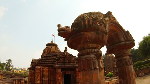 ancient temple Rajarani and arch with bas-reliefs red flag on roof Bhubaneswar Orissa