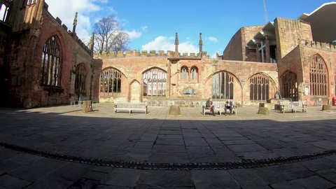 Coventry, West Midlands, UK - March 5, 2019: Time lapse with a wide angle panning around the World War 2 bombed ruins of Coventry Cathedral on a sunny winter day
