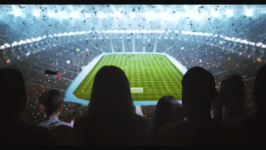 Group of cheering fans watch a sport championship on stadium. Their team wins and everybody are celebrating this event. People are dressed in casual clothes. Colorful confetti fly in the air. | Shutterstock HD Video #1027762928