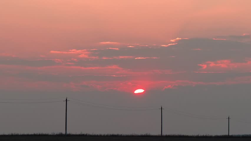 Red sunset over the line of electric power. | Shutterstock HD Video #1027911518