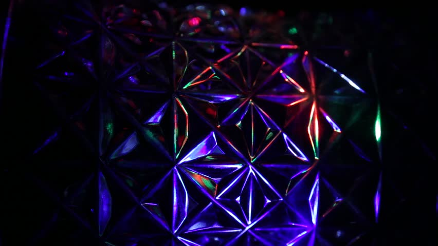 On a crystal background iridescent rays of light   Shutterstock HD Video #1027961168