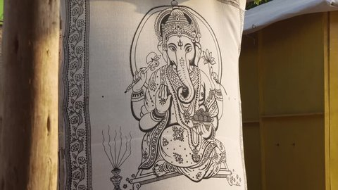 Lord Ganesha Sequin Cotton, fabric material Painted canvas hanging in doorway, India.