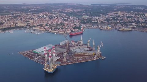 "Shipyard ""Uljanik"" near Pula with heliport, cranes and oil tanker."