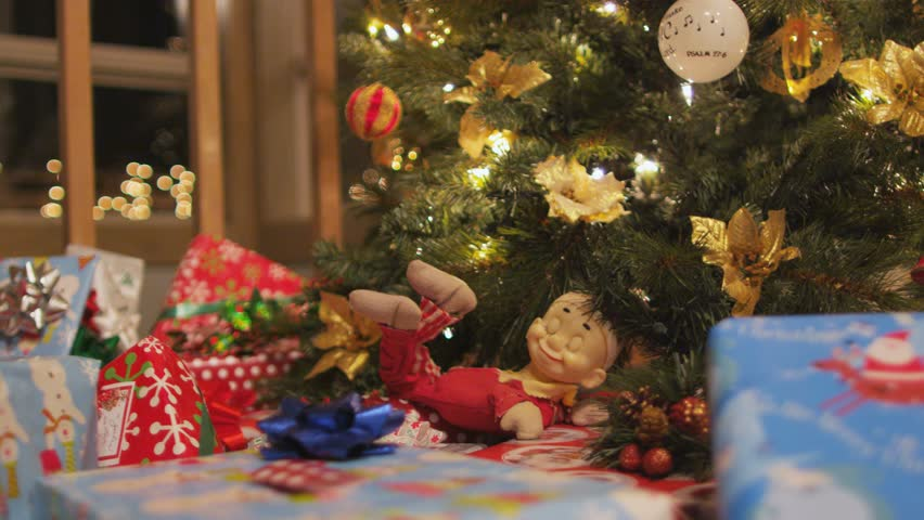 Dolly across presents and christmas tree  | Shutterstock HD Video #1028096948