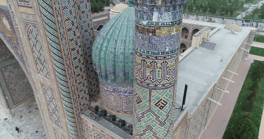 Aerial cityscape The Registan Square is the best place to discover the old Uzbek architecture and to enjoy the great mosaic decorations, Samarkand, Uzbekistan. | Shutterstock HD Video #1028121518