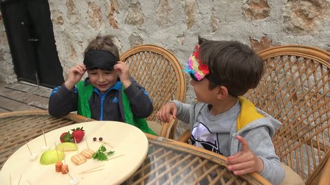 Fethiye, Turkey - 7th of April 2019: Guess what food challenge filming - 4K Two boys play blindfold in guess what food, cryctal child