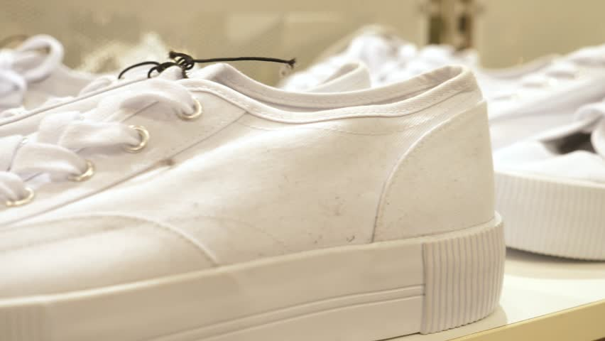 White Female Sneakers On Display At Shoe Shop. Close-Up. | Shutterstock HD Video #1028136338