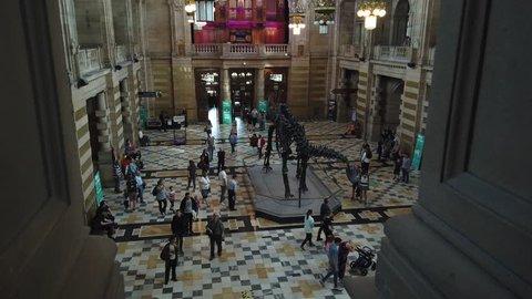 Glasgow, Scotland; April 20th 2019: Visitors viewing the Diplodocus dinosaur skeleton at Kelvingrove Art Gallery and Museum.