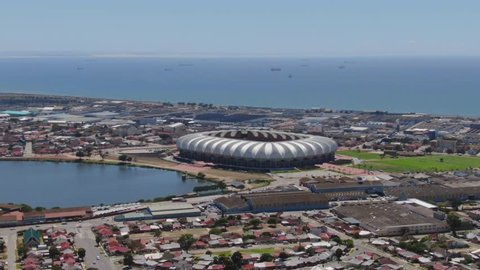 Port Elizabeth, South Africa - circa 2010s: Wide aerial of Port Elizabeth, North End suburban homes, Nelson Mandela Bay Stadium and the ocean on a sunny summer day