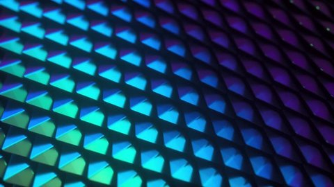 Iridescent glossy scales. Abstract background. Geometric composition with colorful moving tiles. Motion design. Smooth hypnotic wavy pattern. Holographic thin film effect. 3d loop animation. 4K UHD
