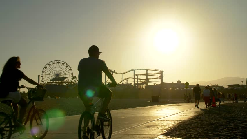 Los Angeles, California / USA - January 6, 2016: Tourists on Bike Path in front of the Santa Monica Pier #1028166338