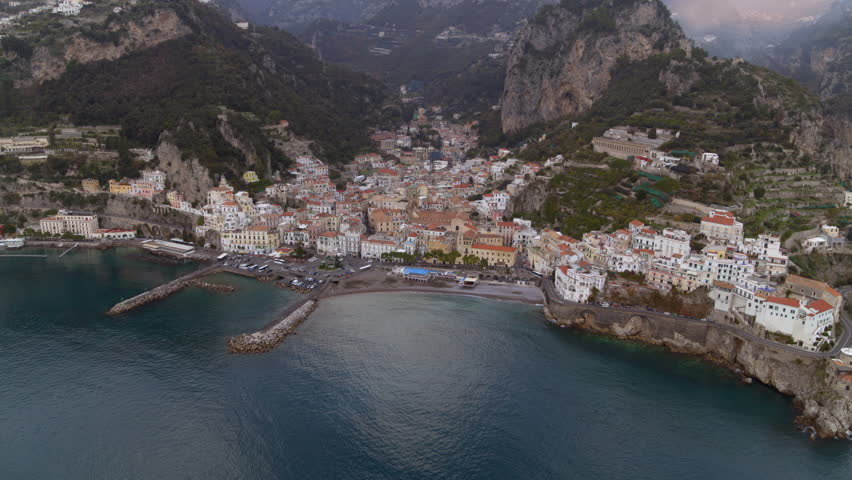 Aerial view of the beautiful Amalfi Coast, Italy. Establishing shot of travel and vacation destination. Italian landscape. | Shutterstock HD Video #1028190878