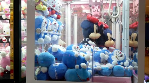 Kuala Lumpur,Malaysia - April 20,2019 : Colorful arcade game toy claw crane machine where people can win toys and other prizes which is located in the shopping mall,Kuala Lumpur.