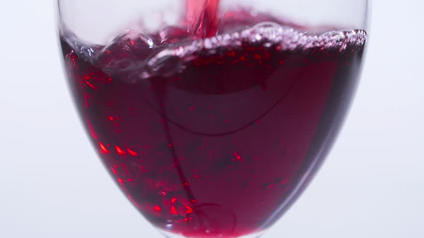 Concept of food and drinks. Red or pink wine poured into a glass on a white background. | Shutterstock HD Video #1028246978