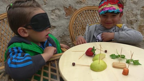 Fethiye, Turkey - 7th of April 2019: Guess what food challenge - 4K Blindfold child guesses what food he is treated