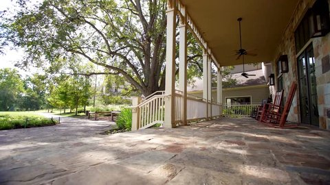 Bastrop, TX / USA - August 16, 2017: Rocking Chairs On Stone Porch, Southern Home, Hospitality