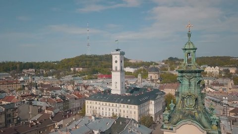 Aerial Roofs and streets Old City Lviv, Ukraine. Central part of old city. European City. Panorama of the ancient town. City Council, Town Hall, Ratush, old church Lviv Latin Cathedral. Drone shot