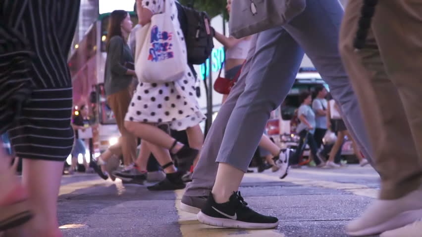 HONG KONG, CHINA - CIRCA MARCH, 2019: Customers crossing intersection on busy road in central of big asian city. Crowded crosswalk. #1028377448