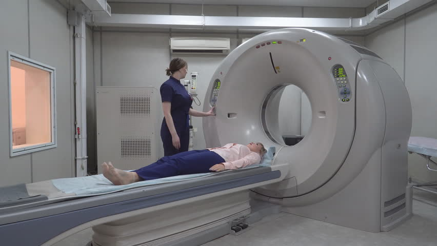 A scanning room with computers and monitors next to the CT scan room in a new modern cancer treatment hospital. 4k | Shutterstock HD Video #1028385998
