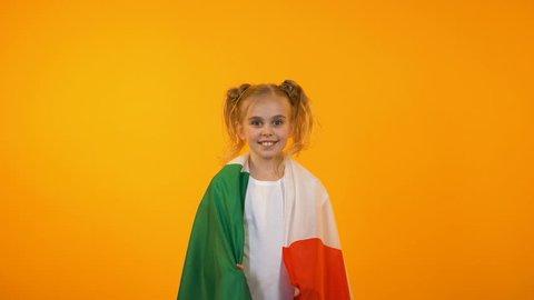 Joyful pretty teenage girl jumping with italian flag, football fan cheering