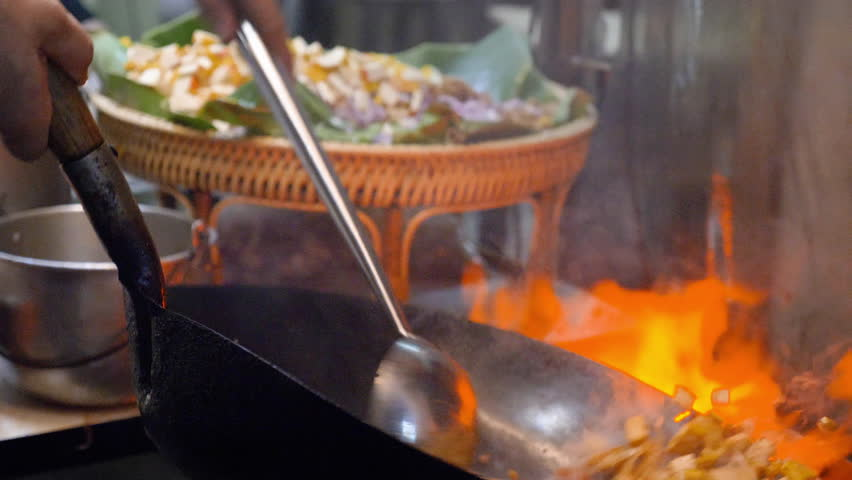 Pad thai favorite and famous Asian Thai street fast food in hot pan, Pad Thai is stir fried rice noodle dish commonly served as a street food and at casual local eateries in Thailand | Shutterstock HD Video #1028391728