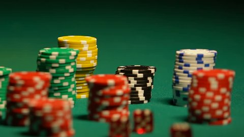 Females hand taking poker chip from table, casino bet, gambling addiction