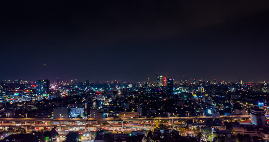 Aerial hyperlapse of Mexico City at night in the San Antonio freeway