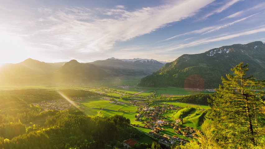 Timelapse of a small village in a valley in the Austrian Alps in the morning | Shutterstock HD Video #1028432228