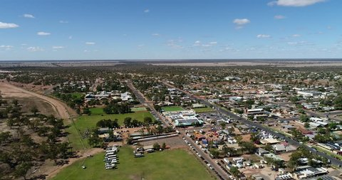 Lightning ridge small regional remote town - centre of opal mining industry in Australia. Aerial elevated view over flat plains and town streets.