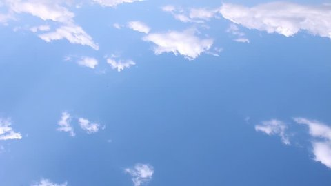 Time lapse white clouds in beautiful summer, sunny lightness horizon, fast moving building nice cloudscape in blue clear, wonderful sky, aerial view. /FHD.
