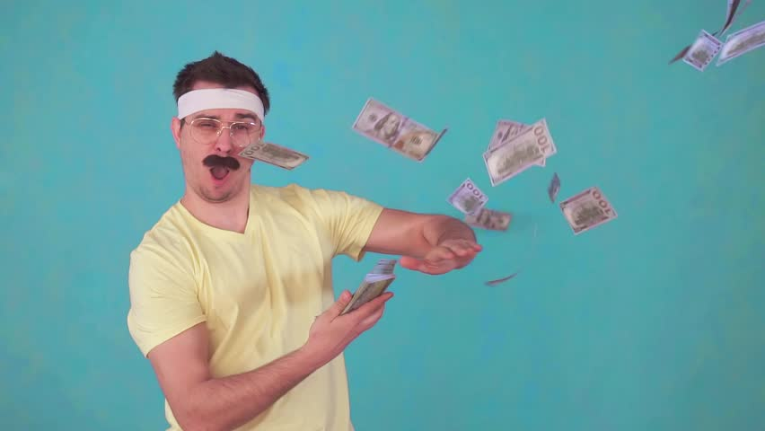 Funny man with a mustache throws money and looks at the camera | Shutterstock HD Video #1028506838