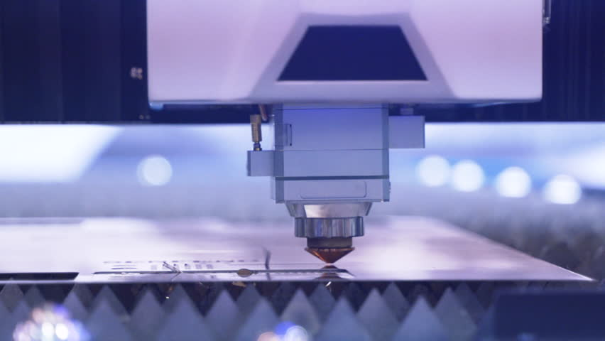 Cut sheet metal at workshop. Modern tool in heavy industry. lot of bright sparks. High precision manufacture of steel parts. Automatic work for ironwork. Close up. computer cnc.   Shutterstock HD Video #1028531048
