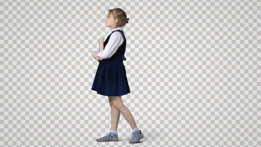 Little Schoolgirl Standing With Book. Stock Footage Video