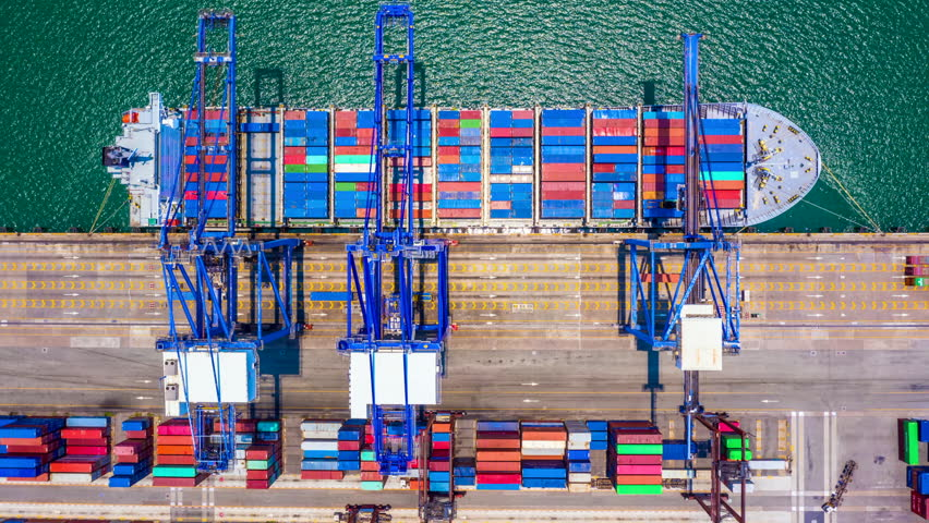 Container ship loading and unloading in deep sea port at Hong Kong, Aerial top view of logistic import export transportation business by container ship in open sea, Timelapse aerial view 4k, Hong Kong | Shutterstock HD Video #1028578238