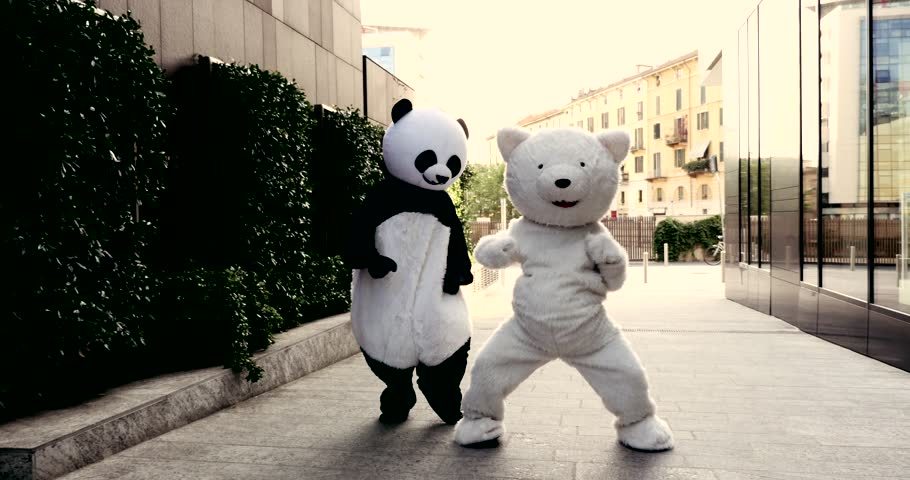 Panda and polar bear dancing in the city to demonstrate and protest against world pollution and animal rights | Shutterstock HD Video #1028599328