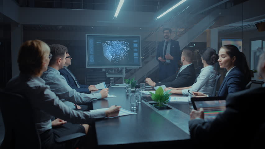 Late at Night in Technological Startup Meeting Room: Chief Engineer Talks Uses Digital Whiteboard to Present New Neural Network, AI, Data Mining Solution to a Board of Investors | Shutterstock HD Video #1028612228