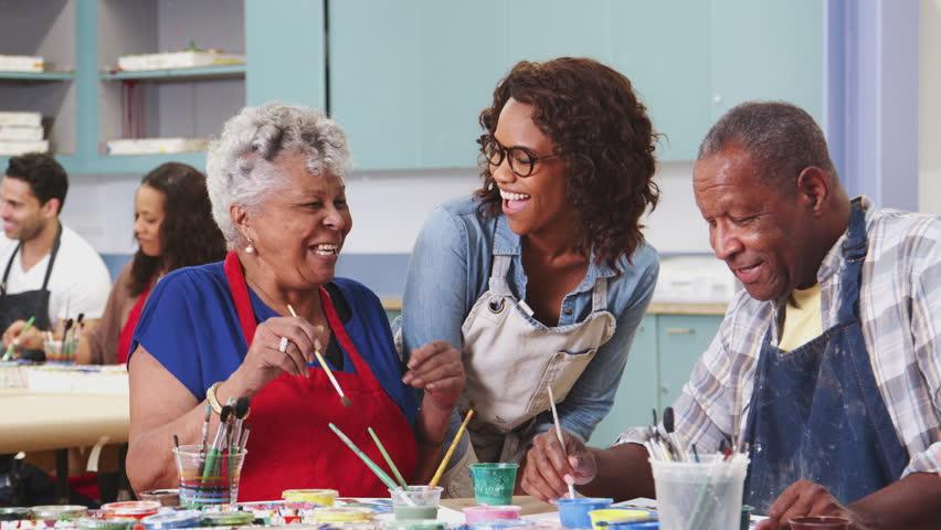 Group Of Retired Seniors Attending Art Class In Community Centre With Teacher | Shutterstock HD Video #1028667548