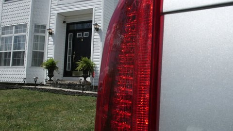 House reveal from car tail light day time
