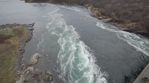 Saltstraumen is a small strait with one of the strongest tidal currents in the world. It is located in the municipality of Bodø in Nordland county, Norway. filmed static shot from above
