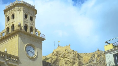 Town Hall in Alicante, Spain. Camera tilts down from a clock tower and then pans left along front of the building.